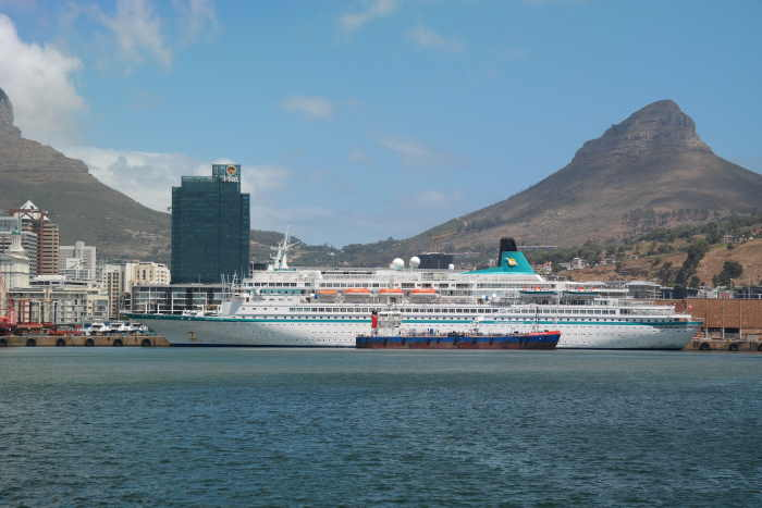 Set against a typical Cape Town backdrop, MS Albatros occupies the cruise berth in Duncan Dock where she is being attended by the bunker barge Southern Valour, featured in Africa PORTS & SHIPS maritime news