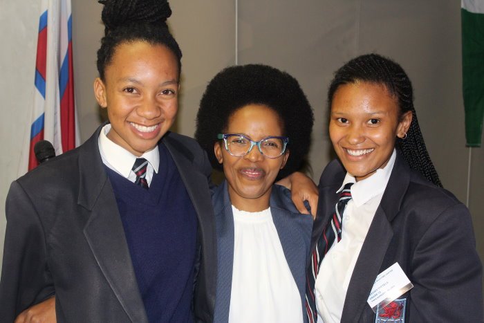 TNPA bursary holders Yolisa Adoon, right, and Cassidy Wittels, left, with Cape Town Port Manager Mpumi Dweba-Kwetana at the Lawhill Maritime Centre's Annual Awards in October, Featured in Africa PORTS & SHIPS maritime news