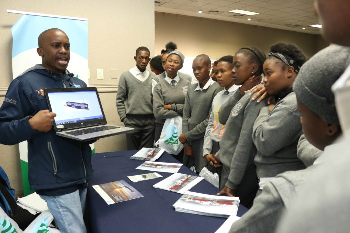 SAMSA exhibitor describing the aspects of a ship to school learners attending the conference, featured in Africa PORTS & SHIPS maritime news