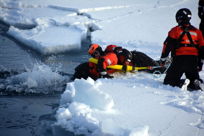 Crewmembers of Healy conduct ice rescue training before establishing an ice station while operating in the Arctic Ocean on 18 September. Prior to allowing scientists and the rest of the crew on the ice floe, Healy's ice rescue team conducts training and establishes a safe area, featured in Africa PORTS & SHIPS maritime news