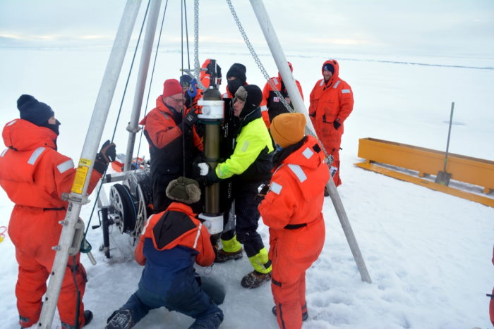 Healy crewmember Ensign Cody Williamson (left) oversees the deployment of an ice profiler by John Kemp and James Dunn of Woods Hole Oceanographic Institute while on an ice floe in the Arctic Ocean on 19 September. The crew and scientists deployed numerous scientific sensors during the ice station to collect data for Arctic research, featured in Africa PORTS & SHIPS maritime news