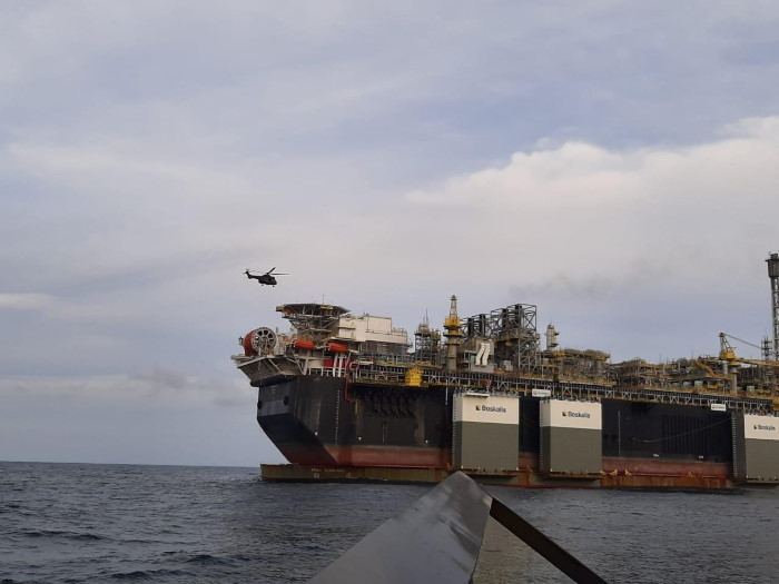 SAAF Oryx helicopter preparing to land on the FPSO being carried on board the Boskalis heavylift vessel Boka Vanguard, report carried in Africa PORTS & SHIPS