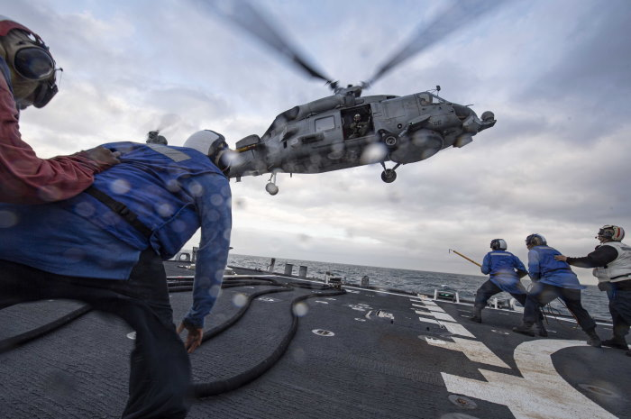 Carney conducted a refuelling evolution (a VERTREP) with a Spanish navy helicopter during a flight quarters evolution on 18 December in the Atlantic. 191218-N-TI693-1308 ATLANTIC OCEAN (Dec. 18, 2019) Sailors assigned to the Arleigh Burke-class guided-missile destroyer USS Carney (DDG 64) conduct a refueling evolution with a Spanish Navy helicopter during a flight quarters evolution, Dec. 18, 2019. Carney, forward-deployed to Rota, Spain, is on its seventh patrol in the U.S. 6th Fleet area of operations in support of regional allies and partners as well as U.S. national security interests in Europe and Africa. (U.S. Navy photo by Mass Communication Specialist 1st Class Fred Gray IV/Released)