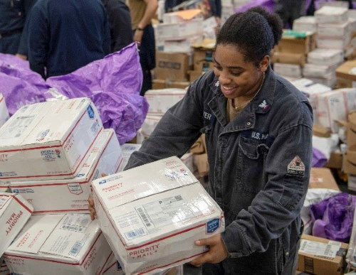 Another navy, another ocean, here a sailor sorts Priority Mail Boxes aboard USS Boxer while underway in the Gulf of Aden. US Navy photo by Petty Officer 3rd Class Jessica Ann Hattell. USN ©, featured in Africa PORTS & SHIPS maritime news