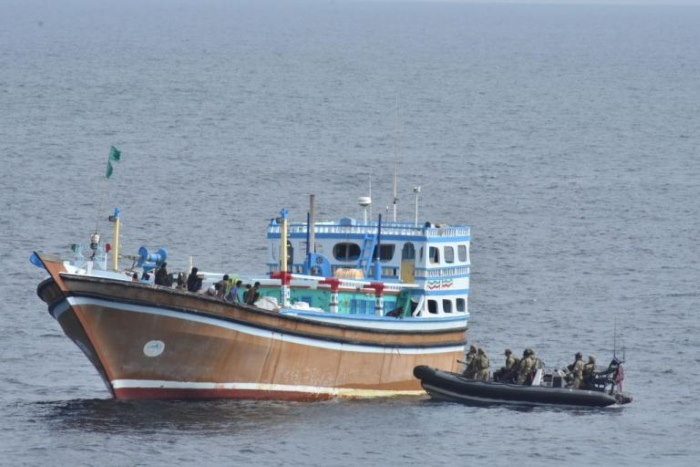 Boarding party from HMS Defender approaching the suspect motorised dhow. featured in Africa PORTS & SHIPS maritime news