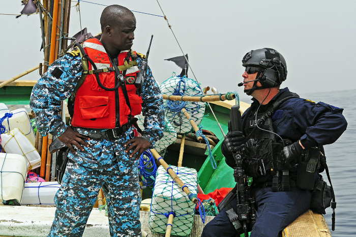 Gambia Navy officer training with officer of the US Coast Guard. Public domain photograph from defenseimagery.mil., featured in Africa PORTS & SHIPS maritime news