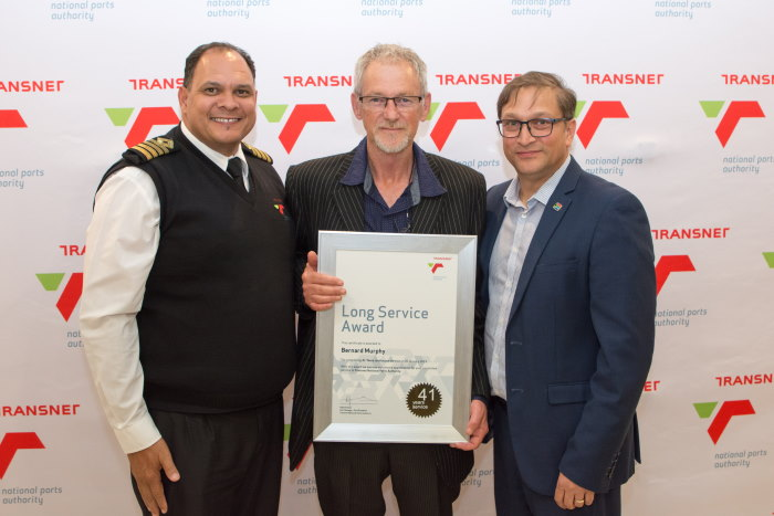 From the left are Captain Brynn Adamson (Harbour Master), Pilot Bernard Murphy and Rajesh Dana (Port Manager of the Port of PE) at the company's long service awards celebration, appearing in Africa PORTS & SHIPS maritime news