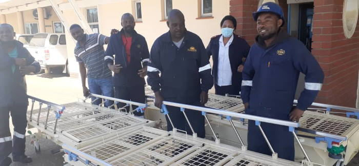 Members of Namdock's technical and fabrication teams, together with a member of Walvis Bay state hospital's nursing staff, with one of the newly-refurbished hospital beds, featured in Africa PORTS & SHIPS maritime news