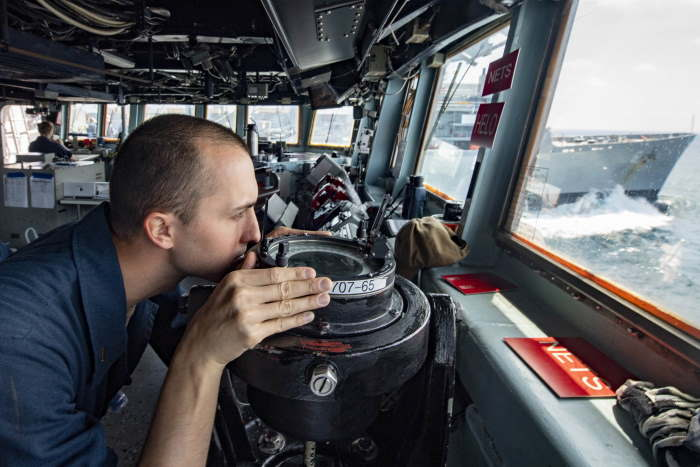 Ensign Alan Cook, from Silverdale, Washington, takes a bearing with an alidade on the bridge of the guided-missile destroyer USS Lassen (DDG 82) in the Arabian Sea on 20 March., featured in Africa PORTS & SHIPS