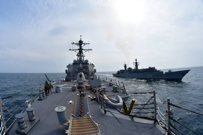The Arleigh Burke-class guided-missile destroyer USS Porter (DDG 78) conducts manoeuvring exercises in the Black Sea with the Romanian navy frigate Regina Maria (F222) on 13 April. Porter, forward-deployed to Rota, Spain, is on her eighth patrol in the US 6th Fleet area of operations in support of US national security interests in Europe and Africa. US Navy photo by Lieutenant Andrew Stopchick Palacio/Released. Photo: USN ©, featured in Africa PORTS & SHIPS maritime news