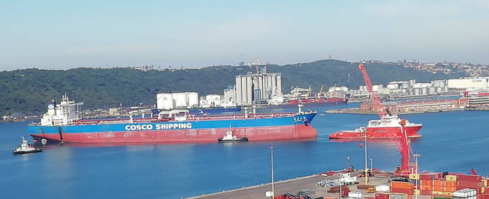 Yuan Hua Hu arriving in Durban under the tow of AMSOL's chartered tug Pacific Dolphin, assisted by AMSOL's Smit Siyanda and four harbour tugs. All pictures by Kevin McGregor, featured in Africa PORTS & SHIPS maritime news