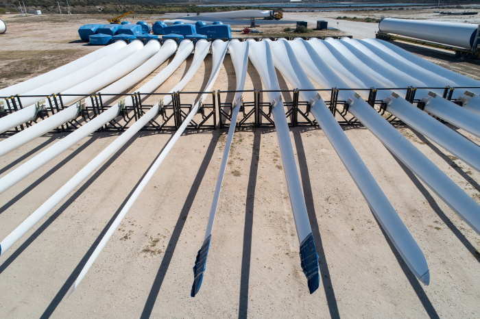 Wind turbine tower components (top) and blades (bottom) stored in the Port of Ngqura before being transported by road and assembled at various wind farms throughout the country. Picture: TNPA, featured in Africa PORTS & SHIPS maritime news