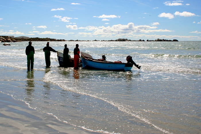Fisermen launching their open boats into the sea at Paternoster. Picture: Wikipedia, featured in Africa PORTS & SHIPS maritime news