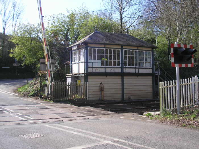 A onetime typical and now rare manned signal box in England. This one is 100 miles north of London on the line from the Port of Felixstowe to the industrial Midlands. Note the lever controls seen inside the windows. Here are controlled signals, points and the road traffic barrier. There has been a railway here since 1848.   Picture: PWR ©, featured in Africa PORTS & SHIPS maritime news
