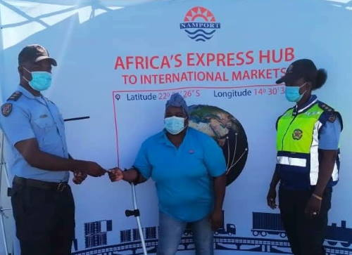 Ms Edith Kukuri handing over the office keys to Inspector Shapumba at the port of Walvis Bay and featured in Africa PORTS & SHIPS maritime news