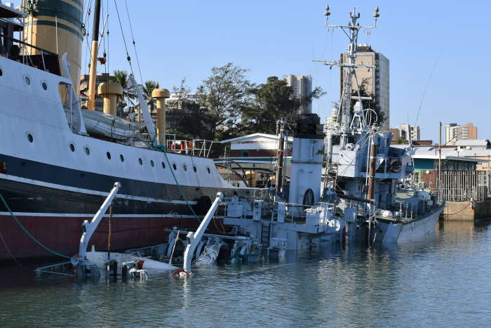 SAS Durban resting on her shallow seabed on 1 July 2020, now awaiting a decision to her fate, picture: Trevor Jones, featured in Africa PORTS & SHIPS maritime news