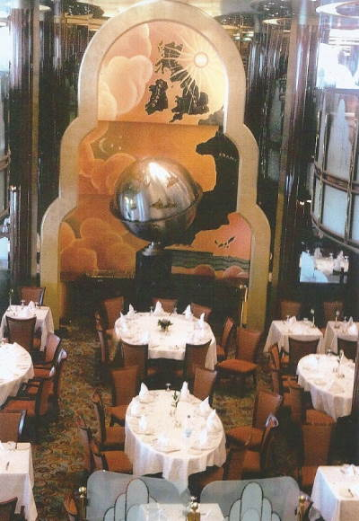 Scene of Fine Dining - The Britannia Restaurant, showing the Captain's Table under the Globe, featured in Africa PORTS & SHIPS maritime news
