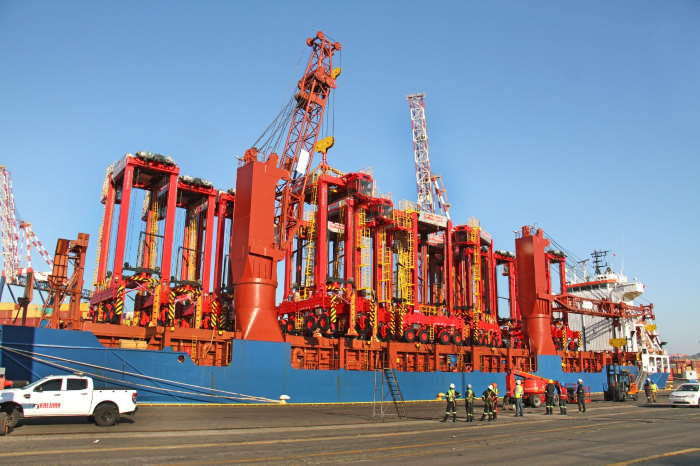 One of the eight new straddle carriers being discharged from the vessel BBC Texas in Durban harbour. Featured in Africa PORTS & SHIPS maritime news