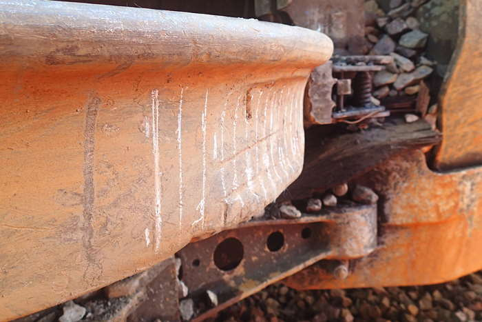 Right-hand leading wheel of third wagon, on its side after the derailment, showing flat spot on wheel tread and false flange. Photo: RAIB Crown Copyright 2020 ©, featured in Africa PORTS & SHIPS maritime news