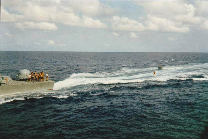 It wasn't all work and no play in the navy - here one of the crew is seen skiing behind a fast-moving strike craft, featured in Africa PORTS & SHIPS maritime news