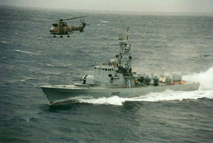 Boat number 3 with Air Force chopper overhead, featured in Africa PORTS & SHIPS maritime news