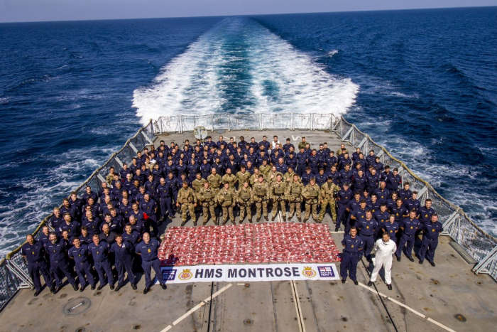 The crew of HMS Montrose stand with 275kg heroin seized from a suspect dhow. Picture: AET Josh Edwards RN, featured in Africa PORTS & SHIPS maritime news