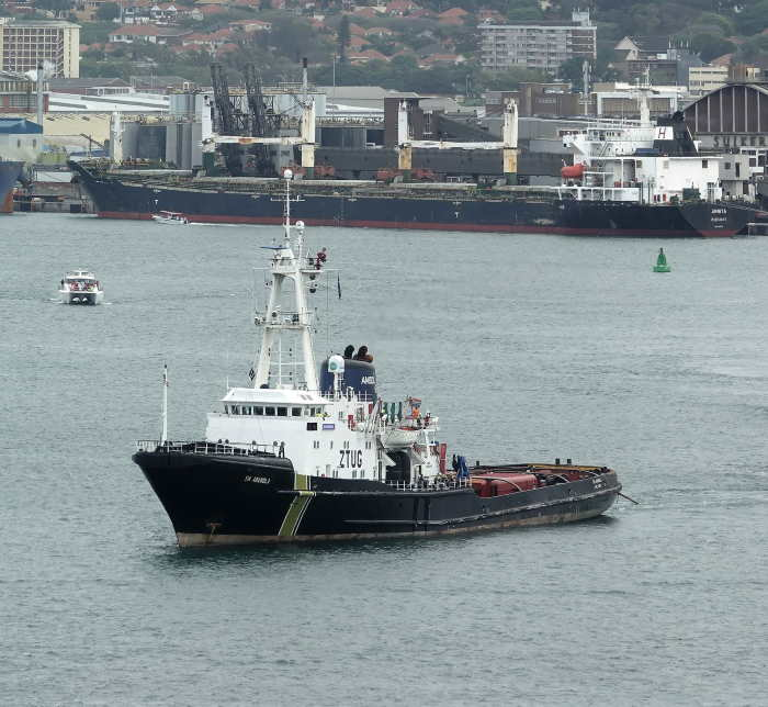 AMSOL's salvage tug, SA Amandla, which is currently towing the derick barge MCDERMOTT 50 to Jebel Ali via Durban. Here the famous tug, once one of two most powerful salvage tugs in the world, is seen with the tow of a floating dock (unseen) in Durban harbour. Picture courtesy Roy Reed Photography, featured in Africa PORTS & SHIPS maritime news