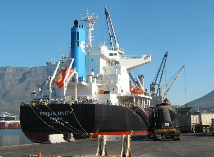 Proud Unity as the lorries queue for their turn under the hoppers. Do note the birds on the ship's hawser Picture by 'Dockrat'and featured in Africa PORTS & SHIPS maritime news